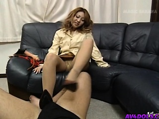 Yuuko puts feet in shoes on high phallus