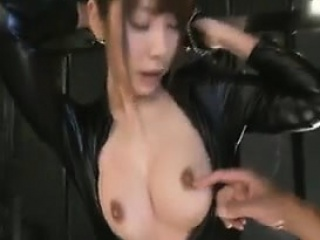 Submissive Oriental babe fro arms fro a Negro latex device exposes he