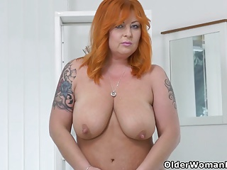 Redhead milf Alex strips off together with fingers their way mature pussy