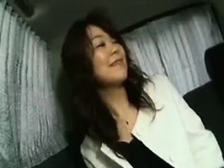 Enticing Japanese lady flashes the brush superb boobs and sucks a