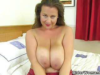 Busty increased by British milf Eva Jayne stuffs her fuckable cunt