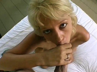 Charming young lady is delighting mate with loose blowjob