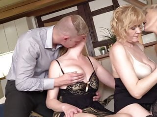 Three mature mothers sharing young lass
