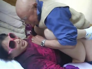 Chinese granny is having fun approximately grandpa